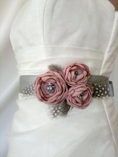 Handcrafted Pink and Grey Three Flowers With Feathers Wedding Bridal Sash Belt. $41.90, via Etsy.