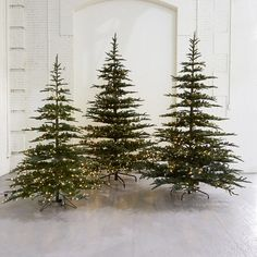 Our essential for effortless holiday decorating, this faux fir tree arrives pre-lit with warm white LEDs. Strikingly natural, each tree is modeled aft