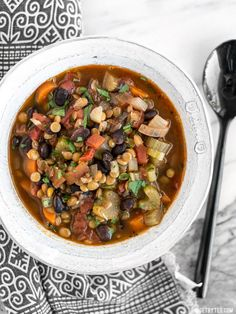 This easy Chunky Lentil and Vegetable Soup is packed with color, flavor, texture, and good-for-you vegetables! BudgetBytes.com
