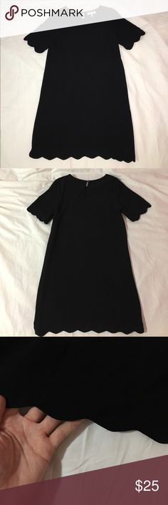 Black Short Sleeve Dress with Scalloped Hem This adorable dress hasn't been worn and is in great condition. The sleeves and bottom of the dress are scalloped with a keyhole back. It's perfect to wear to work or for a night out! Monteau Dresses Mini