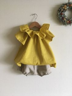 Cotton Ruffled Collar Smock Mustard For Baby Girl Feel the spring. . .🎈🎈🎈 to buy shorts and frocks I made a short-sleeved smock with mustard-colored linen with a little green on the yellow.😍 #cottonfrock #babygirl #mustard #shortsleeved #youngchildren #turtletop #fluffycollar