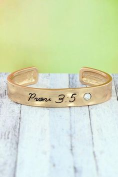 """Share your favorite verse with this simple, yet stylish cuff. Worn Goldtone Crystal Accent """"Prov Inscribed on Bracelet Inside Circumference Including Gap Wide No Closure Lead Compliant Religious Jewelry, New Fashion, Cuff Bracelets, Fashion Jewelry, Crystals, Stylish, Simple, Products, New Trends"""