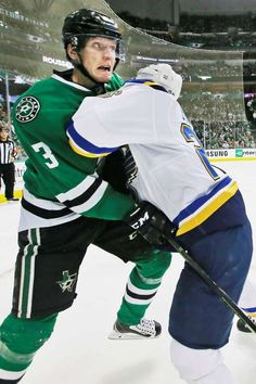 Game face: Dallas Stars defenseman John Klingberg (3) is hit by St. Louis Blues center Paul Stastny during the second period in the first game of the playoff series in Dallas on April 29. - © LM Otero/AP Photo