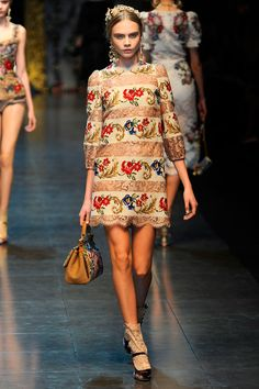 The floral bands of this dress are found in antique needlepoint rugs. Image courtesy Vogue.