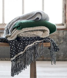 This soft yarn blanket is complete with a twisty fringe.