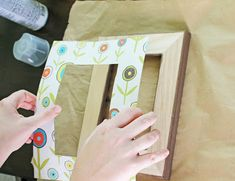 Take inexpensive frames and scrap paper and you'll have stylish Easy Decoupage Frames for your home! If you're looking for decoupage ideas, this homemade picture frames is a simple afternoon project that add a pop of color to a wall or coffee table. Homemade Picture Frames, Homemade Pictures, Old Picture Frames, Picture Wall, Diy Decoupage Frame, Frame Crafts, Decoupage Ideas, Small Milk Bottles, Framed Scrapbook Paper