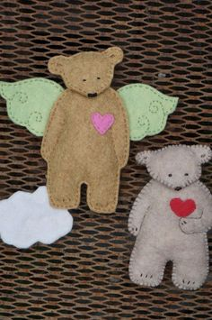 Bears! Bears! Bears! is a PATTERN for making all of these sweet simple handmade woodland bears. One is giving his heart to you, one is sleepy and the last is an angel with wings and a cloud. These are sweet simple bears that a beginner should be able to make . The easily downloaded pdf file contains the pattern, illustrations and easy to follow directions for hand sewing these bears. As always, please do not leave infants and young children unattended with small objects as they may choke on…