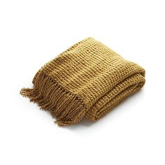 Shop Landyn Gold Chunky Knit Throw.  A textural weave of chunky acrylic and chenille yarns craft a warm, heavy weight throw that's great to snuggle under.  Accented with five-inch fringe, it drapes a golden layer over a sofa or armchair.