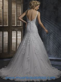 Maggie Sottero Ella dress... love the lace and the buttons