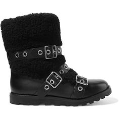 Marc by Marc Jacobs Eyelet-embellished leather and shearling boots (167.615 CLP) ❤ liked on Polyvore featuring shoes, boots, black, pull on leather boots, black slip on shoes, buckle boots, leather slip-on shoes and pull on boots