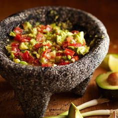 Chunky Guacamole - Garlic, red onion, and plum tomatoes make up this coarsely mashed crowd-pleasing Mexican appetizer. More party ideas: http://www.bhg.com/holidays/mothers-day/recipes/host-a-cinco-de-mayo-celebration/
