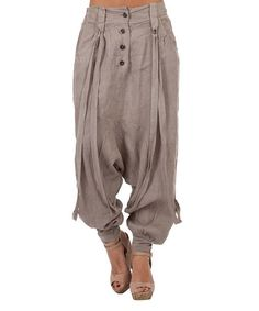 These slouchy linen harem pants feature a button front and contemporary draping straps for added interest.Size note: This item runs in European sizing. Please refer to the size chart.