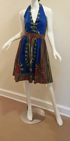 Feel Vibrant in this pure cotton dress made from the East African Kanga Fabric. You'll Shine!