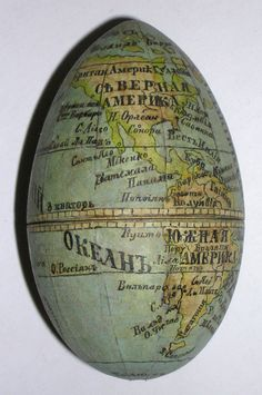 Nesting Russian egg-shaped globe. An outer egg of Karelian birch opens to reveal an egg-shaped pocket globe. The globe opens to reveal a metal compass. Text in Russian. Made of Karelian birch in the early 20th century. Outer egg 3.75 inches tall x 2.5 inches wide, globe 3 inches tall x 1.75 inches wide. (We have other pocket globes on our web site at georgeglazer.com, but this one is sold.)