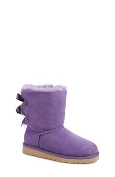 Free shipping and returns on UGG® Australia 'Bailey Bow' Boot (Walker, Toddler, Little Kid & Big Kid) at Nordstrom.com. Super-cozy suede is fashioned into a favorite short boot trimmed with double bows at the back. The soft, cozy lining is made from genuine shearling or plush UGGpure, a textile made entirely from wool but crafted to feel and wear like genuine shearling. Either version keeps feet warm and comfortable, whatever the weather.