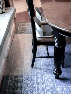 Under dining table mat.  Indoor/outdoor layla rug, with plastic office mats beneath