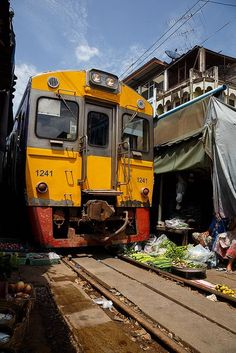 The train rides above the products...Bangkok Market