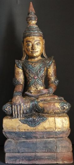 "18th Century Teak Wood Burmese Arakan Buddha Statue. Gild worn with age, glass mosaic and thayo lacquer decoration  ""Original article found here Read More http://goldentriangleantiques.com/burmese-arakan-teak-wood-buddha-statue."