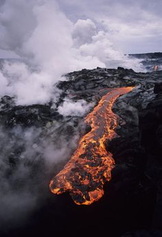 ✮ Hawaii, Big Island, Hawaii Volcanoes National Park, Molten lava flow, Steam clouds in distance
