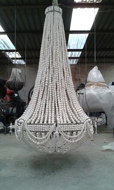 Elongated XL chandelier in hand rolled clay/ ceramic beads. We choose not to work with cheap imported wooden beads as we support a community of HIV affected women. By choosing to use these beads we support over 157 families every month. This obviously massively impacts our costs and our price to the customer but we all need to take a stand to responsibly help those around us! Thank you for supporting us in our decision to make a real difference! Beware of wooden bead copies…