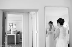A beautiful bride getting ready in our Presidential Suite for her Wedding at Le Meridien Arlington. Photograph by Birchtree Photography!
