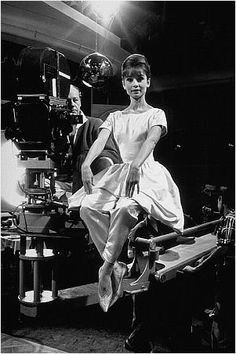 """Paris When It Sizzles"" Audrey Hepburn poses for a fashion layout while director R. Quine looks on"