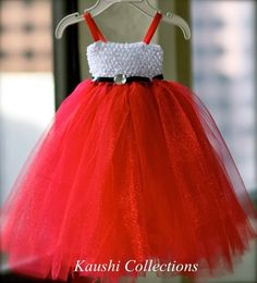 Use a headband to tie the knots through to make an American girl holiday dress. Use tulle spool.