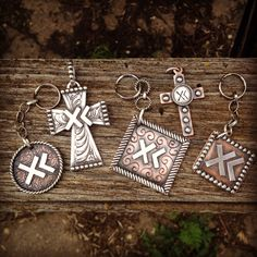 Custom brand crosses and keychains, handmade by Silo Silver