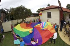 rainbow parachute games- I HAVE TO find this for Grace! Rainbow Party Games, Rainbow Unicorn Party, Rainbow Parties, Rainbow Birthday Party, Unicorn Birthday Parties, Rainbow Theme, Birthday Ideas, 5th Birthday, Care Bear Party
