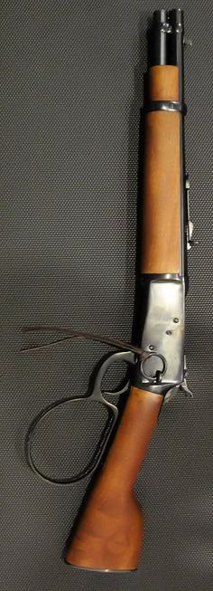 "Rossi Ranch Hand rifle 02   Steve Mcqueens'  ""mares leg"" from  ""Wanted Dead or Alive"" tv show.  He was a bounty hunter."