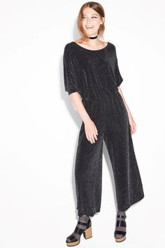 Turn up the volume in this stretchy, swingy and sparkly party jumpsuit with a ruched elastic waist and wide legs.