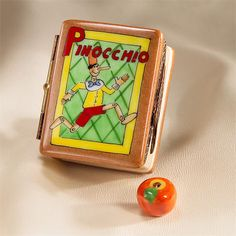 Limoges Pinocchio Book Box with Apple.