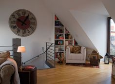 Clock And Stairs Daring Penthouse in The Exquisite City of Cologne Incorporating a Strong Personality