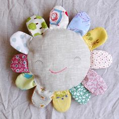 baby toy....could sew a bell inside and maybe us a wipe wrapper as crinkle inside the 'petals' .....cute.