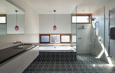 Contemporary bathroom with colorful floor tiles