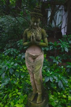 stone goddess in the wooded garden draped in sweet clinging moss.