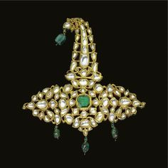 A gem-set and enamelled turban ornament (Sarpech), India, probably Deccan, 19th century  the gold openwork body set with foiled white stones possibly diamonds and an a central octagonal emerald, with a central floral medallion flanked by hinged petal florets and surmounted by a hinged curling jigha, four drilled pendant emeralds, the reverse with gold floral and foliate motifs reserved against a green enamelled ground, suspension cord.