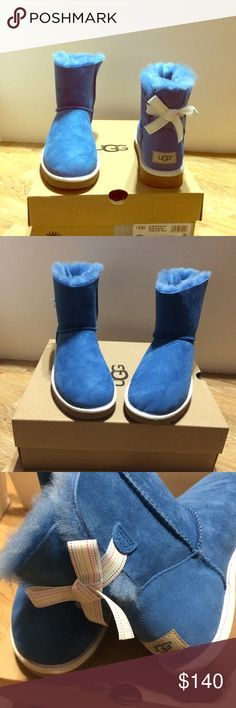 UGG Mini Bailey Bow Authentic-Blue with Rainbow stripe ribbon , soft sheepskin insoles. Size Treadlite by UGG. Pair with leggings & skinny jeans. Please ask questions. Ugg Boots With Bows, Bootie Boots, Ankle Boots, Mini Baileys, Bailey Bow, Ugg Shoes, Fashion Design, Fashion Tips