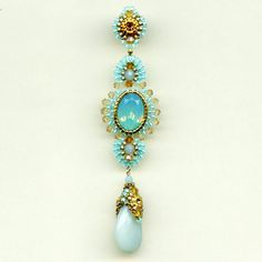 Robins Egg Earring - Miguel Ases  * I MUST learn how to do the beaded cap over the pear beads