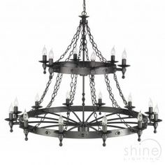 Warwick WR18 GR by Elstead Lighting. This is a medieval styled 18 light circular pendant.  Features 2 layers of lights. Hand crafted from wrought iron. Finished in graphite black.   Made in the UK   18 x 60W E15 Lamps (Not included)   Height adjustable prior to installation.   Height: 970mm - 5970mm   Width: 1220mm  £1890