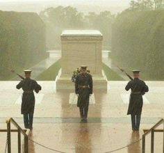 Guards at Tomb of Unknown Soldier in the middle of Hurricane Sandy. Dedication at it finest.