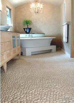 Beautiful white pebble floor tile. https://www.pebbletileshop.com/