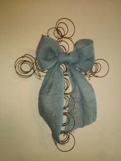 Cross wall hanging...old bed springs and blue burlap bow