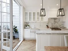 doors opening to terrace/porch/sunroom white cabinets - herringbone floor - move sink to island Home Interior, Kitchen Interior, New Kitchen, Kitchen Dining, Kitchen Decor, Kitchen Black, Basement Kitchen, Kitchen Flooring, White Shaker Kitchen