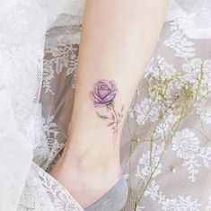50 Stunning Foot Tattoo Designs To Conquer Your Heart These trendy Tattoo Ideas ideas would gain you amazing compliments. Check out our gallery for more ideas these are trendy this year. 1 Tattoo, Get A Tattoo, Tattoo Shop, Mini Tattoos, Flower Tattoos, Small Tattoos, Tattoos For Women Flowers, Foot Tattoos For Women, Purple Rose Tattoos