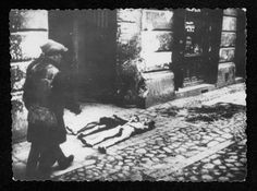 Warsaw, Poland ghetto, Two bodies on the pavement.