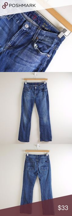 7 for All Mankind Lexie Kimmie Petite Jeans Medium wash, mid-rise, boot cut jeans. Pre-owned but in great condition. Comes with distressing at waistband and pocket. Slight wear apparent at the leg hem as photographed.  Inseam: 29 inches Rise: 8 inches Waist: 28 inches 7 for all Mankind Jeans