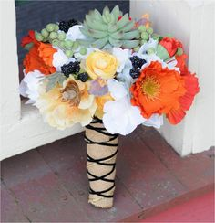Bouquet with Vibrant Poppies, Succulents, Ranunculus and Blackberries