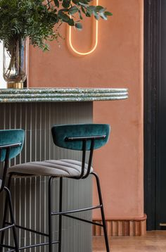 The material and colour palette reinforces the Mediterranean theme, with polished terracotta walls, multicoloured terrazzo tiles and end-grain wooden floors contributing to a warm and cohesive scheme.
