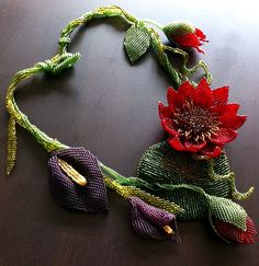 Beaded necklace with water lilies and by Gemsplusleather on Etsy